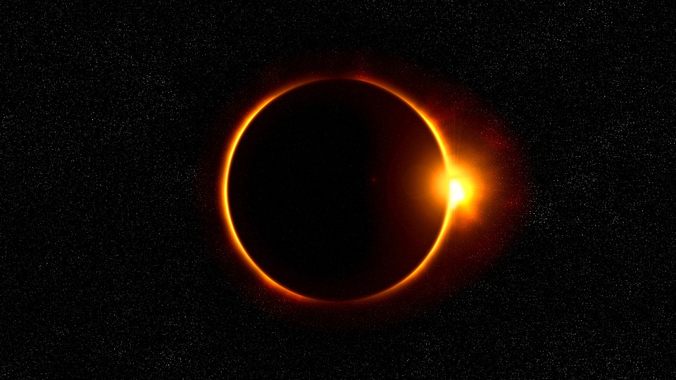 View of solar eclipse in dark sky